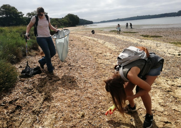 A couple of network volunteers hard at work cleaning up the beach