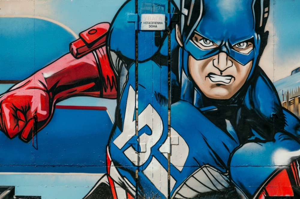 Street graffiti showing captain America in an action pose