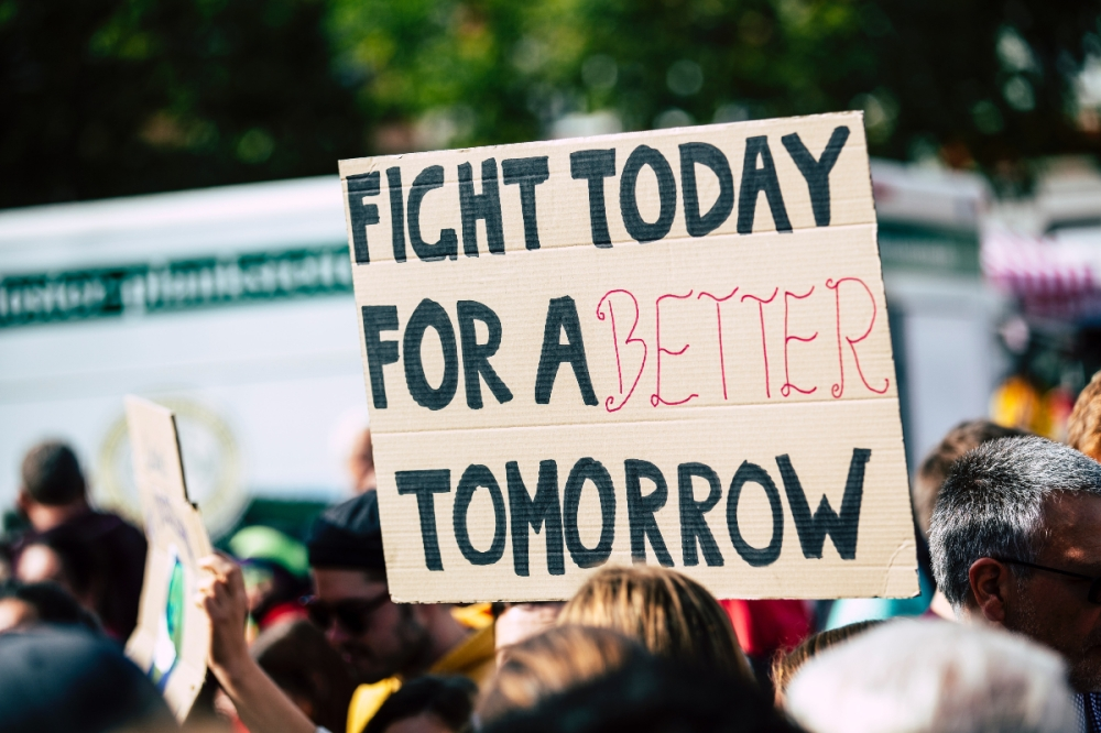 A protest sign saying fight for a better tomorrow today