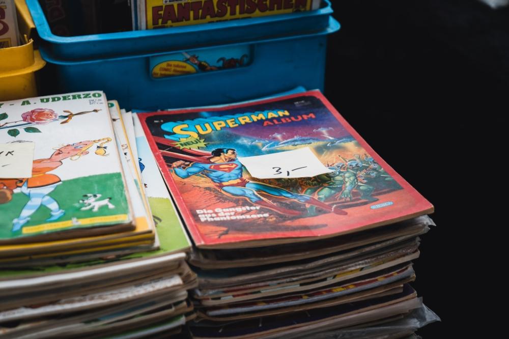 Stack of superhero comics in a book shop
